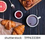 breakfast on the black table.... | Shutterstock . vector #599633384