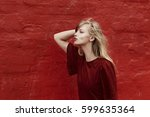 beautiful blond woman blowing... | Shutterstock . vector #599635364