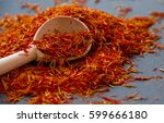 saffron in a spoon on a dark...   Shutterstock . vector #599666180