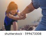 man help hand giving... | Shutterstock . vector #599673308