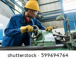 asian worker checking quality... | Shutterstock . vector #599694764
