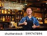 portrait of cheerful barman... | Shutterstock . vector #599747894
