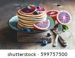 pancakes with blood oranges ... | Shutterstock . vector #599757500