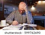 an elderly man calculates the... | Shutterstock . vector #599762690