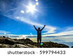 man after hiking to the top of... | Shutterstock . vector #599794433