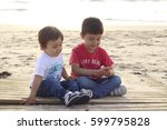 happy children playing in the beach