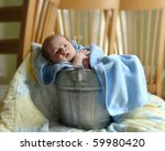 tiny baby relaxes in a rustic... | Shutterstock . vector #59980420