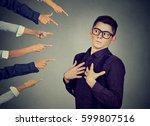 blaming you. anxious man in... | Shutterstock . vector #599807516