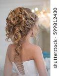 hair styling  bare back | Shutterstock . vector #599812430