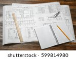 open blueprints on wooden table ... | Shutterstock . vector #599814980