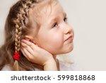 child has a sore ear. little... | Shutterstock . vector #599818868