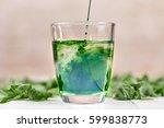 green chlorophyll drink in...   Shutterstock . vector #599838773