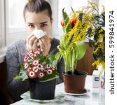 Small photo of The girl suffers from pollen allergy during the spring flowering and uses napkins