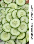 cucumber slices as background.... | Shutterstock . vector #599848394