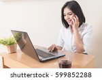 smiling businesswoman using... | Shutterstock . vector #599852288