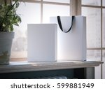 white box and shopping bag on a ... | Shutterstock . vector #599881949
