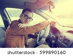 driving instructor in glasses... | Shutterstock . vector #599890160