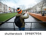 back view of a tourist who... | Shutterstock . vector #599897954