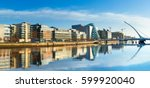 Stock photo modern buildings and offices on liffey river in dublin on a bright sunny day bridge on the right 599920040