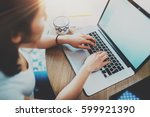closeup of woman surfing web at ... | Shutterstock . vector #599921390