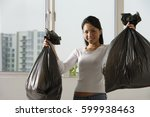 young asian woman holding up... | Shutterstock . vector #599938463
