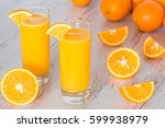 orange juice in glasses at... | Shutterstock . vector #599938979