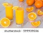 orange juice in glasses at... | Shutterstock . vector #599939036