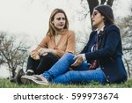 two sylish girls sitting on the ... | Shutterstock . vector #599973674