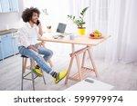 handsome man working on laptop... | Shutterstock . vector #599979974