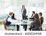 business team gives a... | Shutterstock . vector #600026948