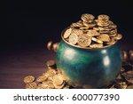 gold coins in a green pot on a... | Shutterstock . vector #600077390