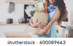 young woman holding grocery... | Shutterstock . vector #600089663
