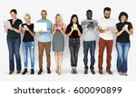 Group Of Diverse People Using...