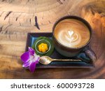 cup of hot coffee latte with...   Shutterstock . vector #600093728