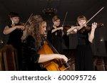 Musician Play Violin On Dark...