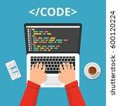 programmer coding on laptop... | Shutterstock .eps vector #600120224