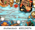 different food cooked on the... | Shutterstock . vector #600124076
