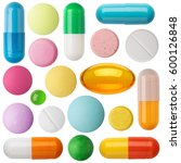 Small photo of Many colorful pills and tablets isolated on white.
