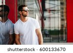 white shirt mock up on a man... | Shutterstock . vector #600133670