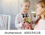 happy little girl giving... | Shutterstock . vector #600154118