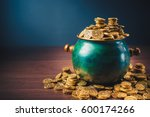 Gold Coins In A Green Pot On A...