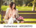 young serious brunette woman in ... | Shutterstock . vector #600180593
