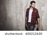 dude in checked shirt  studio | Shutterstock . vector #600212630