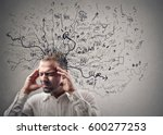 a mess in his head | Shutterstock . vector #600277253