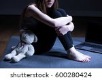 molested girl with teddy bear... | Shutterstock . vector #600280424
