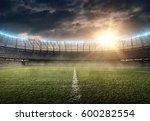 soccer stadium on a sunset | Shutterstock . vector #600282554