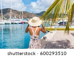 young woman with sun hat in... | Shutterstock . vector #600293510