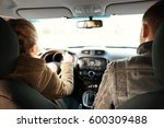 young woman passing driving... | Shutterstock . vector #600309488