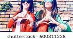 cheerful young girlfriends... | Shutterstock . vector #600311228