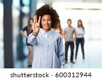 young black woman doing number... | Shutterstock . vector #600312944